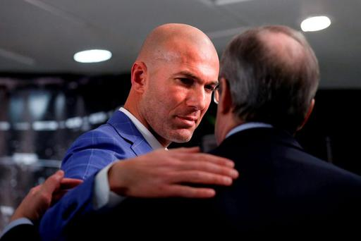 Real Madrid's new coach Zinedine Zidane (L) embraces Real Madrid's President Florentino Perez at Santiago Bernabeu stadium in Madrid