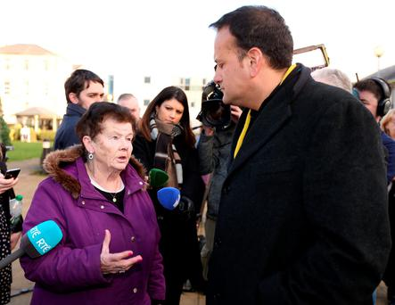 Maureen McEvoy, from Drimnagh, speaks to Health Minister Leo Varadkar at St James's Hospital, Dublin, during his tour of six emergency departments to inspect trolley levels. Photo: Collins