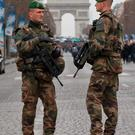Soldiers of the Foreign Legion patrol along the Champs Elysees in Paris. AP Photo/Michel Euler