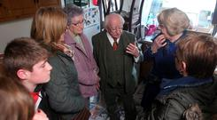 President Michael D Higgins and his wife Sabina speak with flood victim Elizabeth O'Connor in Enniscorthy, Co Wexford. Damien Eagers