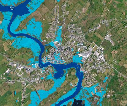 Carrick-on-Shannon: Satellite shots show flooding around rivers. Dark blue shows the river banks, while lighter blue areas show flooded areas.