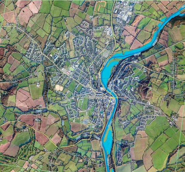 Enniscorthy: Satellite shots show flooding around rivers. Dark blue shows the river banks, while lighter blue areas show flooded areas.