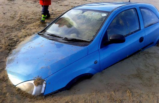 The car, which had to be abandoned on the strand at Bettystown, was swallowed by sand after the tide came in