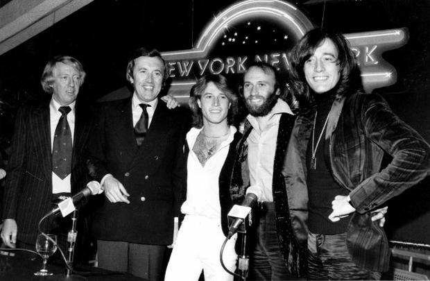Robert Stigwood, David Frost and the Bee Gees (AP/PA)