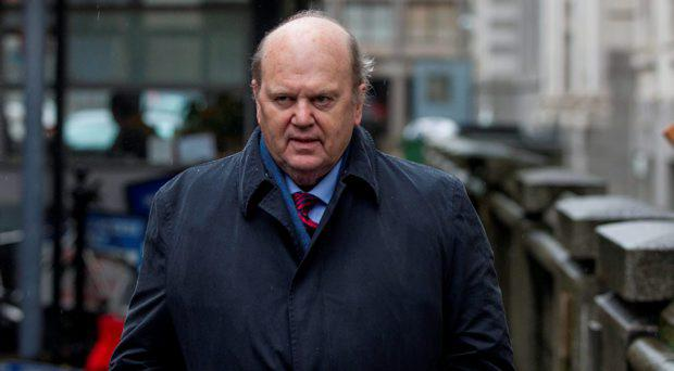 Minister Michael Noonan arriving at the Department of Finance this morning after spending Christmas in hospital after undergoing surgery