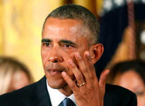 U.S. President Barack Obama wipes away a tear while announcing steps the administration is taking to reduce gun violence while delivering a statement in the East Room of the White House in Washington