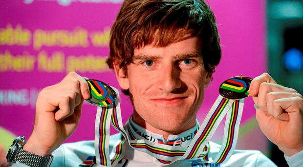 Martyn Irvine, who announced his retirement yesterday, displaying his UCI World Track gold and silver medals in 2013. Photo: Paul Mohan /Sportsfile