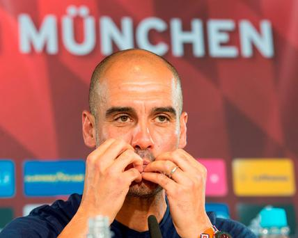Pep Guardiola in pensive mood during a press conference in Munich yesterday. PETER KNEFFEL/AFP/Getty Images