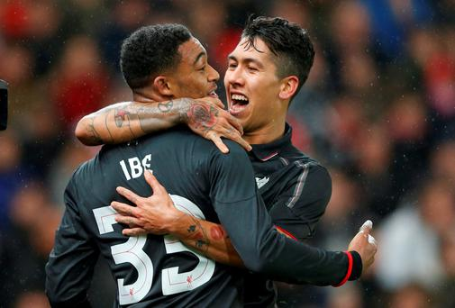 Jordon Ibe celebrates with Roberto Firmino after scoring the first goal for Liverpool during the winner over Stoke. Photo: Reuters / Carl Recine.