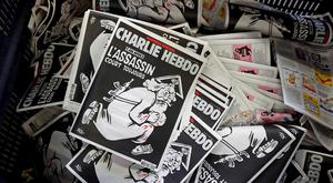 Copies of the latest edition of French weekly newspaper Charlie Hebdo with the title