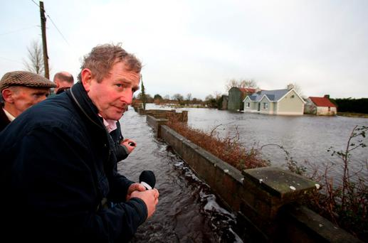 Taoiseach Enda Kenny onboard a tractor trailer as he toured the area of Carrick-On-Shannon. Brian Lawless/PA Wire