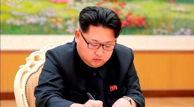 North Korean leader Kim Jong Un signs a document regarding the test of a hydrogen bomb, in this still image taken from KRT video and released by Yonhap on January 6, 2016. North Korea's state-run television KRT on Wednesday released still photographs of Kim ordering the conduct of a nuclear test