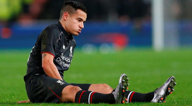 Liverpool's Philippe Coutinho reacts after sustaining an injury before being substituted against Stoke