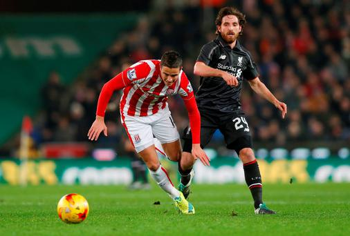Liverpool's Joe Allen in action with Stoke's Ibrahim Afellay