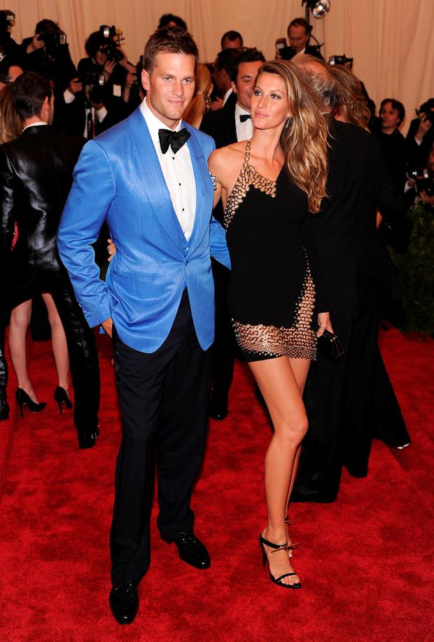 NFL player Tom Brady (L) and model Gisele Bundchen attend the Costume Institute Gala for the