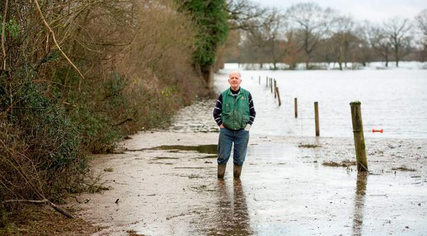 ICMSA President John Comer visiting the farm of Donal Hynes of Ahane (right) at which he repeated his call for an end to petty inter-agency disputes and a single national waterways authority with power to dredge and clear waterways and rivers. Pic Sean Curtin Fusionshooters.