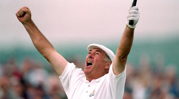 Christy O'Connor Jnr of Ireland celebrates victory in the British Senior Open at the Royal County Down Golf Club in County Down, Northern Ireland