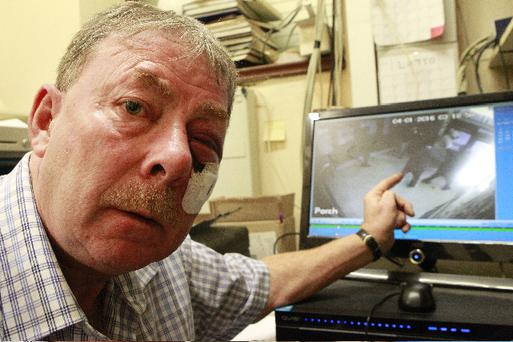 John Ryan views CCTV images of the attack. Photo: Courtesy of The Star