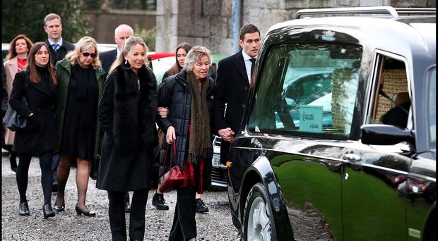The remains of Wesley Burrowes are brought to Christ Church, Bray Co Wicklow by his family including wife Helena and son Kim and daughter Ciara (Glasses). Pic Steve Humphreys 6th January 2015