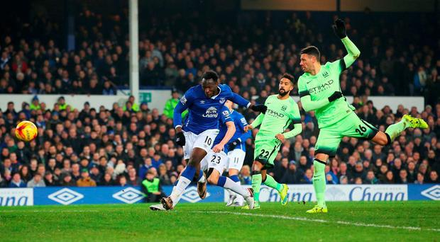 Romelu Lukaku of Everton scores his team's winner during the Capital One Cup Semi Final First Leg match between Everton and Manchester City at Goodison Park