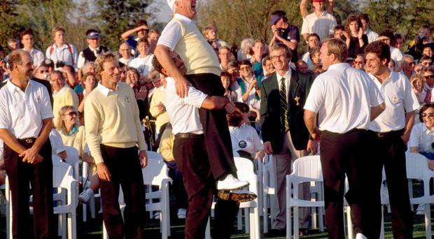 Christy O'Connor Jnr is lifted up by team-mate Sam Torrance after Europe's victory in the 1989 Ryder Cup. Photo: Phil Sheldon/Popperfoto/Getty Images