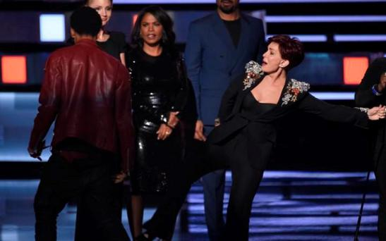 Sharon Osbourne kicks out at stage invader at the People's Choice Awards