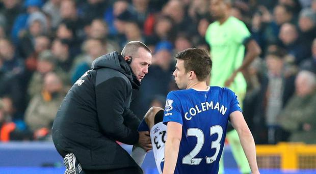 Everton's Seamus Coleman receives treatment to a injury during the Capital One Cup, semi final, first leg match at Goodison Park