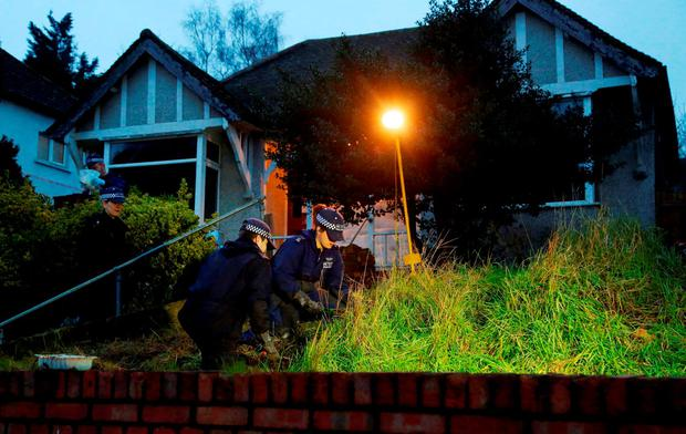 Police search officers investigate the front garden of the house in Erith, Kent, which is being searched by the police officers in relation to Sian Blake. Gareth Fuller/PA Wire