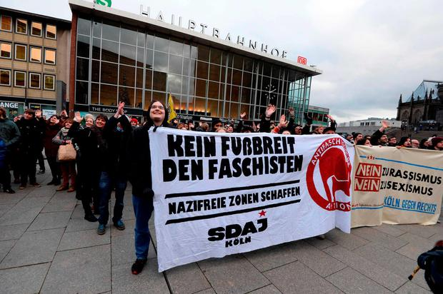 Socialist German Workers Youth members demonstrate against the right wing party Pro NRW gathering in front of the main train station and the Cathedral in Cologne where dozens of apparently coordinated sexual assaults were perpetrated against women on New Year's Eve Credit: Roberto Pfeil (AFP/Getty Images)