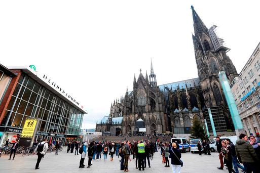 Police officers survey the area in front of the main train station and the Cathedral in Cologne, western Germany, on January 6, 2016, where dozens of apparently coordinated sexual assaults were perpetred against women on New Year's Eve. / AFP / Roberto PfeilROBERTO PFEIL/AFP/Getty Images