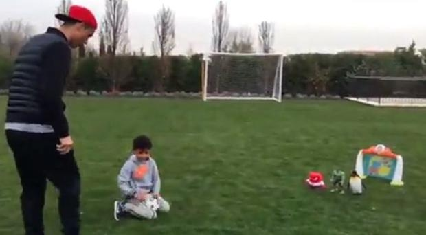 Cristiano Ronaldo and Cristiano Jr were perfecting their free kick technique