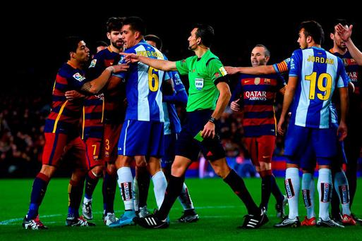 Luis Suarez of FC Barcelona (L) argues with RCD Espanyol players during the Copa del Rey Round of 16 first leg match between FC Barcelona and RCD Espanyol at Camp Nou last night