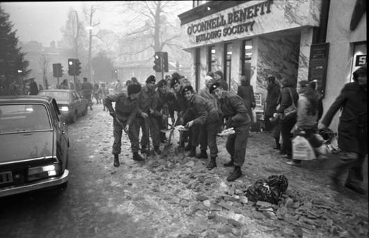 Soldiers clearing ice from footpaths on Grafton Street in January, 1982. Photo: Donal Doherty.