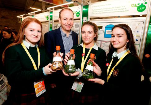 Fianna Fáil leader Micheál Martin with pupils Aoife Rainey, Niamh Daly and Sophie McDevitt from St David's Secondary School, Co Wicklow, with their project titled 'Anaerobic digesters at a local level' at the BT Young Scientist 2016 at the RDS, Dublin, yesterday. Photo: Conor McCabe Photography