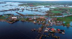 The River Shannon has flooded land in many counties including here in Banagher, Co Offaly. Photo credit: Niall Carson/PA Wire