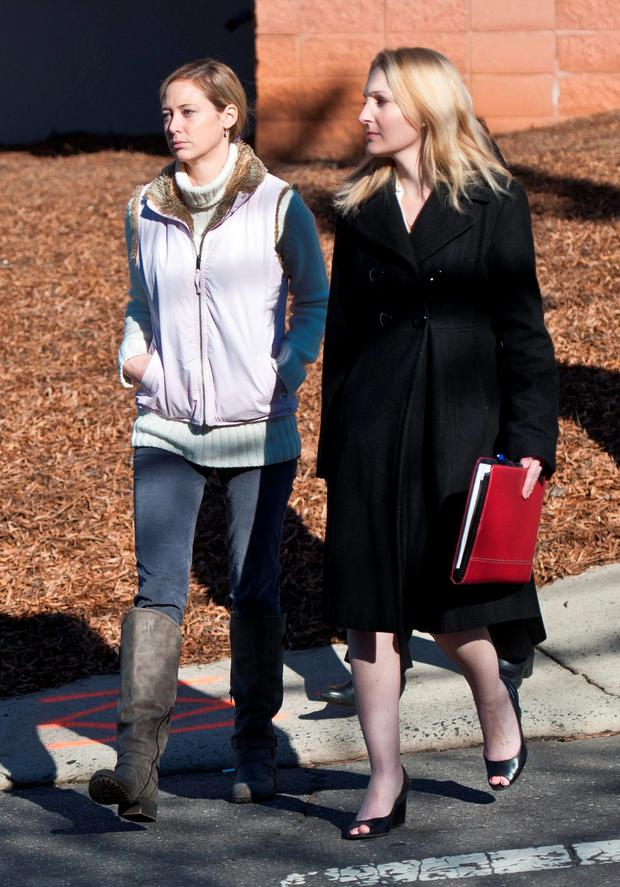 Molly Martens (left) walks with a member of her legal team as they arrive at the courthouse. Photo: Winston-Salem Journal