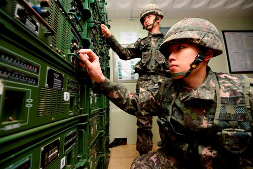 South Korean soldiers adjust equipment at a broadcasting room as they prepare propaganda broadcasts near the border area between South Korea and North Korea in Yeoncheon, northeast of Seoul, on January 8, 2016