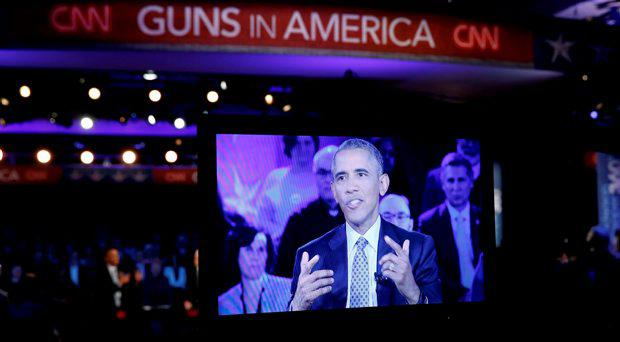 U.S. President Barack Obama is seen on a monitor as he speaks during a live town hall event on reducing gun violence hosted by CNNÄôs Anderson Cooper at George Mason University in Fairfax, Virginia January 7, 2016. REUTERS/Kevin Lamarque