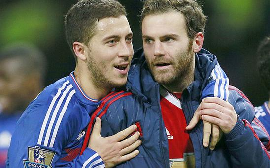 From blue to red: Could Eden Hazard (left) be joining Juan Mata at United? Photo: REUTERS