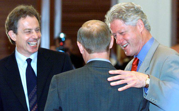 Us President Bill Clinton shares a joke with British Prime Minister Tony Blair and Russian President Vladimir Putin before the start of the last session of the G8 Summit in Nago July 2000