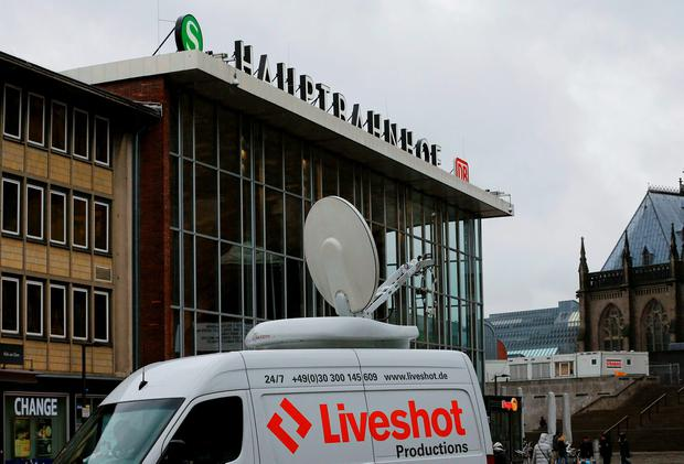 A TV satellite uplink vehicle stands in front of the main railways station of Cologne, Germany January 7, 2016. German police have identified three suspects in connection with attacks on women at New Year celebrations in the city of Cologne