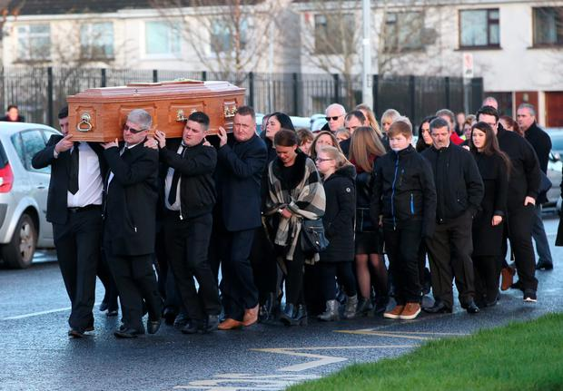 The remains of Claire Hewitt are brought to St Ciaran's Church, Hartstown, for her funeral mass