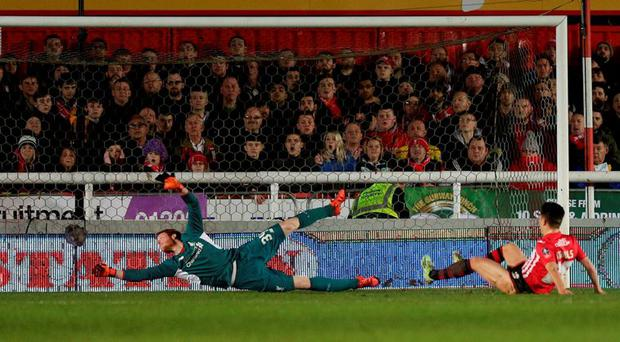 Exeter City's Tom Nicholls scores their first goal