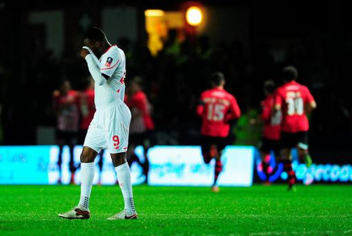 Christian Benteke of Liverpool reacts as Tom Nichols of Exeter City scores the opening goal of the game