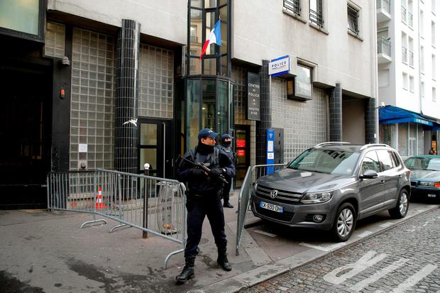 Armed police stand guard yesterday in front of the station where a man was killed Thursday after he showed up wearing fake explosives, in Paris. Photo: AP