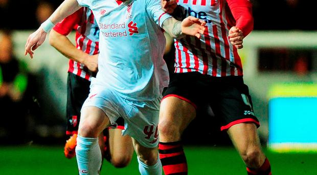 Liverpool's Ryan Kent battles with David Noble of Exeter City. Photo: Dan Mullan/Getty Images