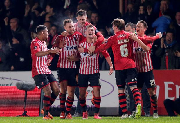 Exeter City's Lee Holmes celebrates scoring their second goal with team mates. Photo: Reuters