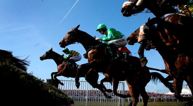 Tour Des Champs, here sailing over a fence at Aintree, can claim today's Welsh National for young jockey Jamie Bargary (Getty)