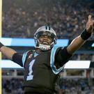 Cam Newton of the Carolina Panthers reacts after a 4th quarter touchdown against the Tampa Bay Buccaneers during their game at Bank of America Stadium on January 3, 2016 in Charlotte, North Carolina (Streeter Lecka/Getty)