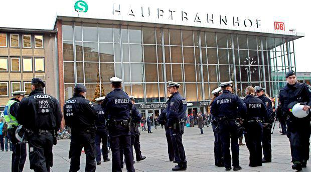 Police officers patrol in front of the main station of Cologne, Germany, on Wednesday, Jan. 6, 2016